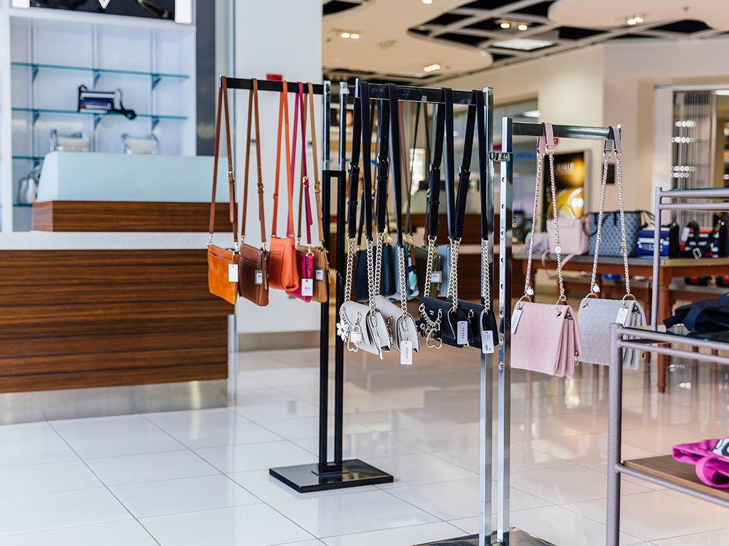 Purses on display in a store